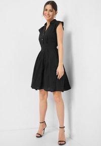 ORSAY - Shirt dress - schwarz - 1
