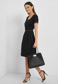 ORSAY - MIT V-AUSSCHNITT - Day dress - schwarz - 1