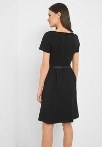 ORSAY - MIT V-AUSSCHNITT - Day dress - schwarz - 2