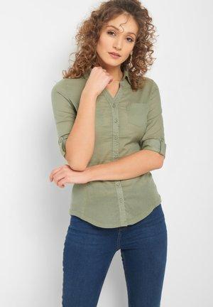 MIT STREIFEN - Button-down blouse - light khaki