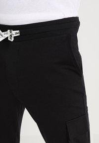 Only & Sons - ONSWF KENDRICK - Pantalon de survêtement - black - 4