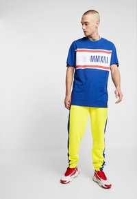 Only & Sons - ONSCOLOR PANTS - Tracksuit bottoms - blazing yellow - 1