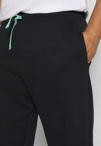 Only & Sons - ONSORGANIC PANTS PLUS - Tracksuit bottoms - black - 4