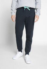 Only & Sons - ONSORGANIC SWEAT PANTS - Verryttelyhousut - black - 0
