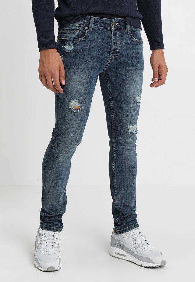 LOOM BREAKS - Slim fit jeans - dark blue denim