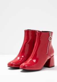 ONLY SHOES - ONLBIMBA HEELED ZIP BOOTIE - Classic ankle boots - red - 4