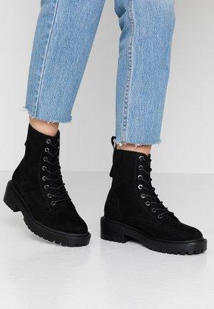 BOLD LACEUP BOOTIE  - Platform ankle boots - black