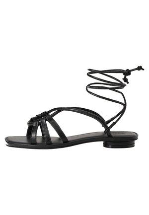 EINFARBIGE SANDALEN ZUM BINDEN 11233580 - Ankle cuff sandals - black