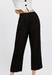 OYSHO - Spodnie materiałowe - black - 0