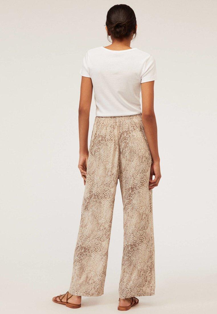 OYSHO Pantalon classique beige