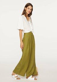 OYSHO - PALAZZO - Trousers - green - 1