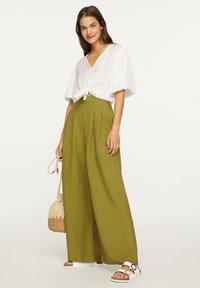 OYSHO - PALAZZO - Trousers - green - 2