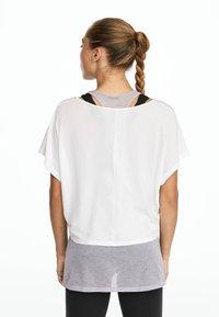 OYSHO_SPORT - Print T-shirt - multi-coloured - 5