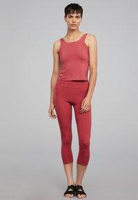 OYSHO_SPORT - T-shirt de sport - rose - 1