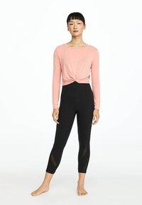 OYSHO_SPORT - Long sleeved top - rose - 1