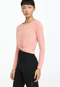 OYSHO_SPORT - Long sleeved top - rose - 0