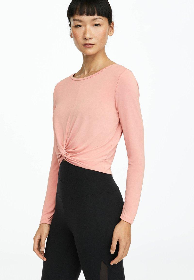 OYSHO_SPORT - Long sleeved top - rose