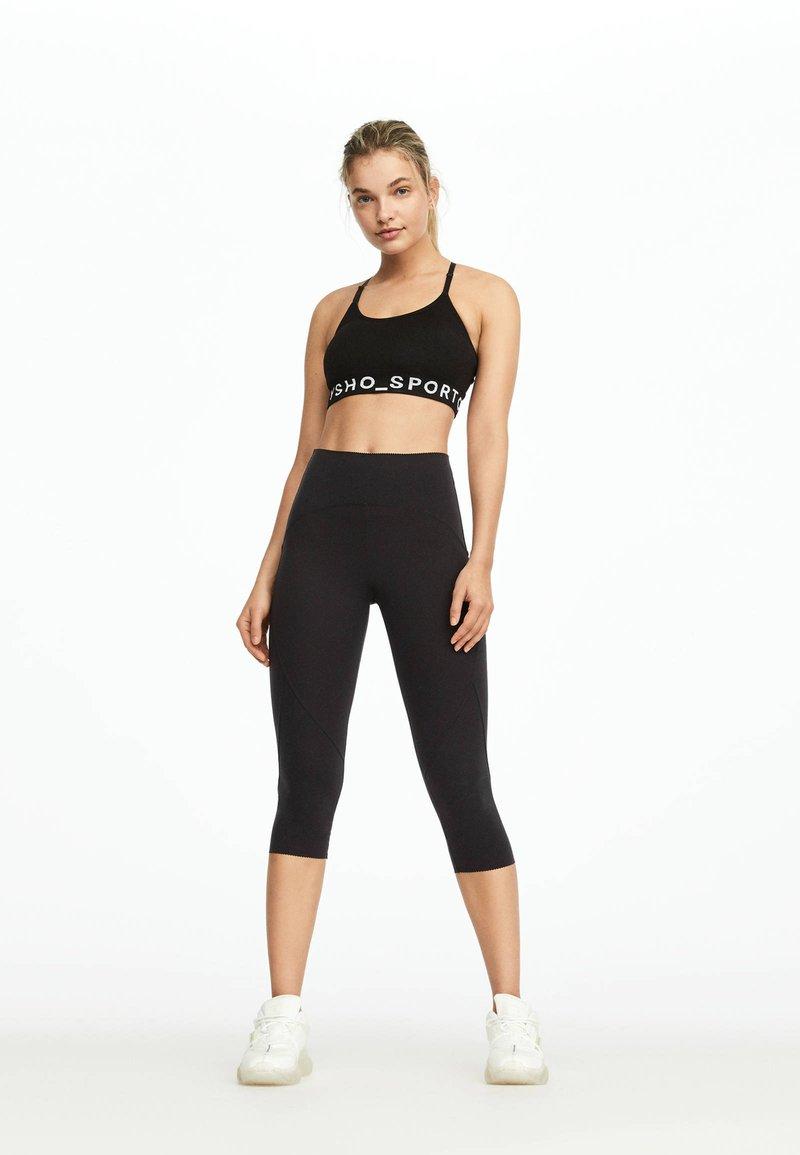 OYSHO_SPORT - HIGH COMPRESSION - 3/4 sports trousers - black