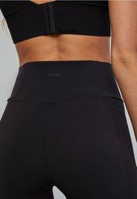 OYSHO_SPORT - FORMENDE RADLERSHORTS 31244206 - Sports shorts - black - 4
