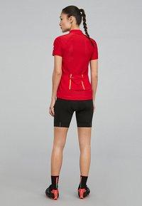 OYSHO_SPORT - SPIN YOUR LIMITS - Sports shorts - black - 2