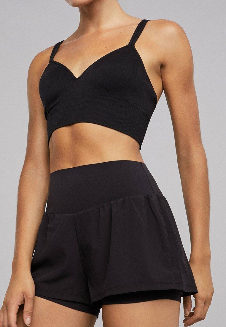 OYSHO_SPORT - Sports shorts - black