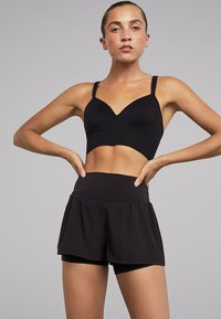 OYSHO_SPORT - Sports shorts - black - 1