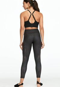 OYSHO_SPORT - MIT ALLIGATOR-PRINT  - Leggings - black - 1