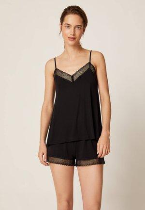 SHORTS IM DESSOUS-LOOK MIT GEOMETRISCHER SPITZE 30102697 - Pantaloni del pigiama - black
