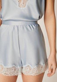 OYSHO - mit Spitze - Pantaloni del pigiama - light blue - 4