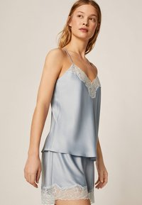 OYSHO - mit Spitze - Pantaloni del pigiama - light blue - 0