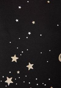 OYSHO - MIT MOND- UND STERNEPRINT - Pyjama top - black - 2
