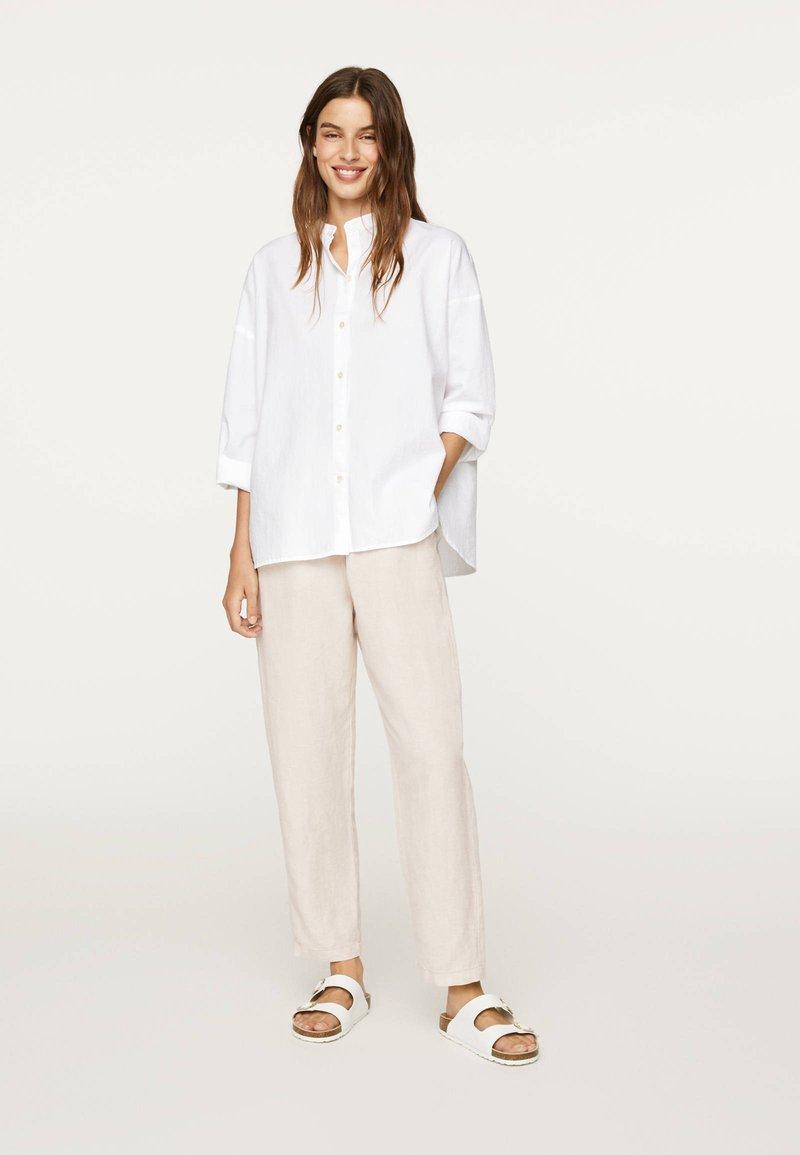 OYSHO - Button-down blouse - white