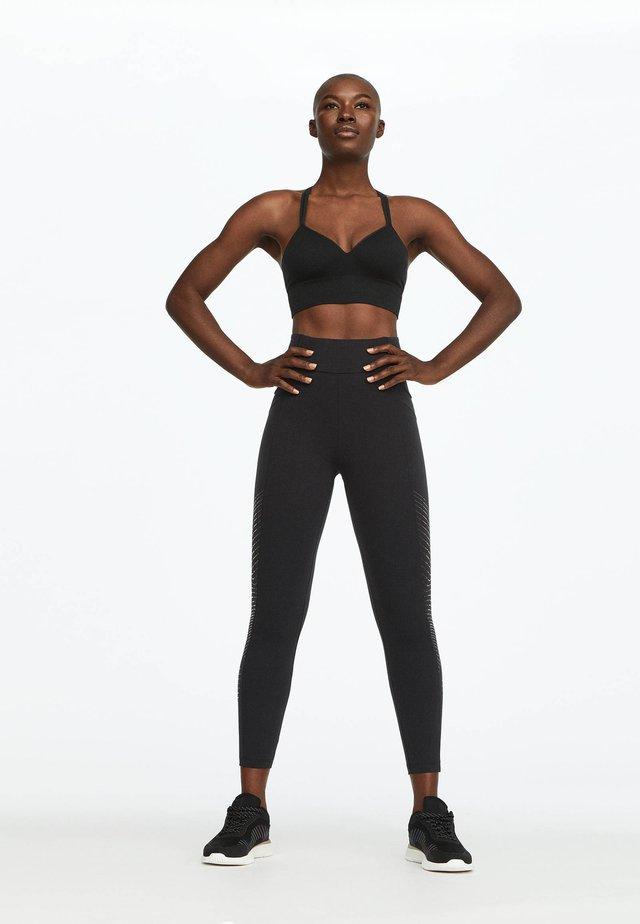 MIT SCHIMMERNDEN DETAILS - Leggings - Trousers - black