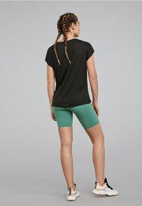 OYSHO_SPORT - Print T-shirt - black - 1
