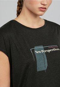 OYSHO_SPORT - Print T-shirt - black - 3