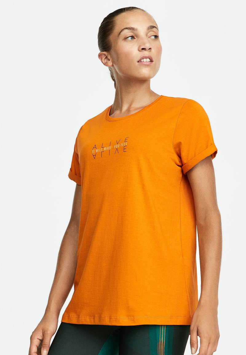 OYSHO_SPORT - T-shirt imprimé - orange