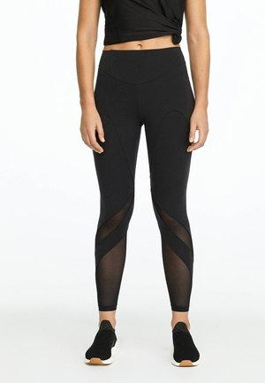 MIT TRANSPARENTEN DETAILS - Leggings - black