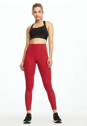 MIT LASER CUT TIGERMOTIV  - Leggings - red