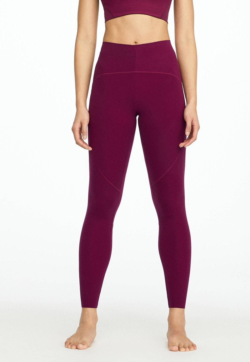 OYSHO_SPORT - Leggings - dark purple