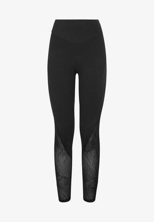 FORMENDE LEGGINGS MIT TRANSPARENTEN DETAILS 31217222 - Leggings - black