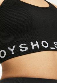 OYSHO_SPORT - MIT LOGO  - Sport BH - black - 4