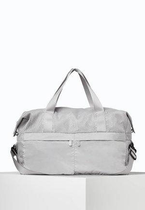 MIT NETZSTOFF - Sports bag - grey
