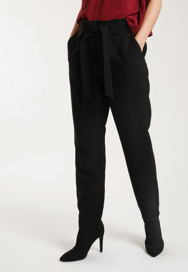 CITY - Trousers - black