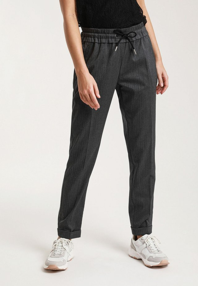 CITY - Trousers - black