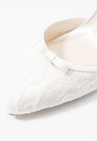 Paradox London Pink - DEVOTION - Svatební boty - ivory - 2