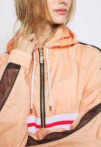 P.E Nation - MAN JACKET - Training jacket - orange pale - 3