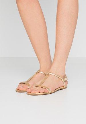 Sandales - gold star