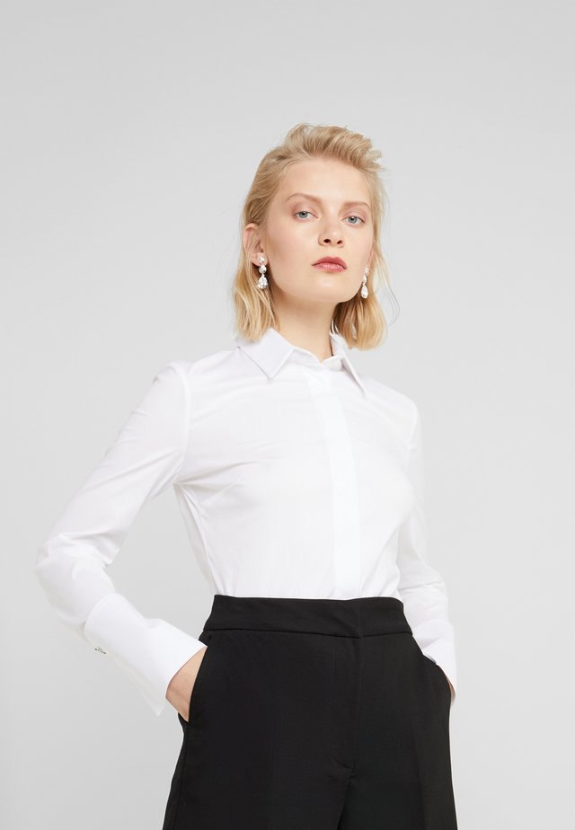 CARRY OVER - Button-down blouse - bianco ottico