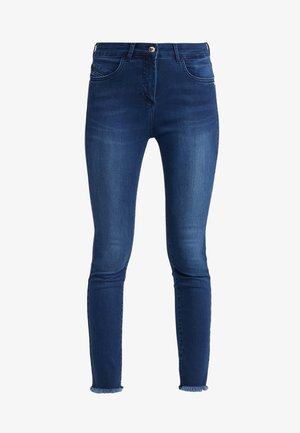 Jeansy Skinny Fit - mid blue