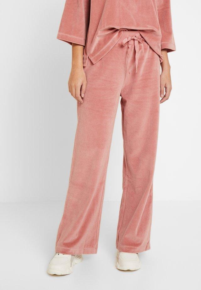 AIDE - Pantalon de survêtement - rose dawn